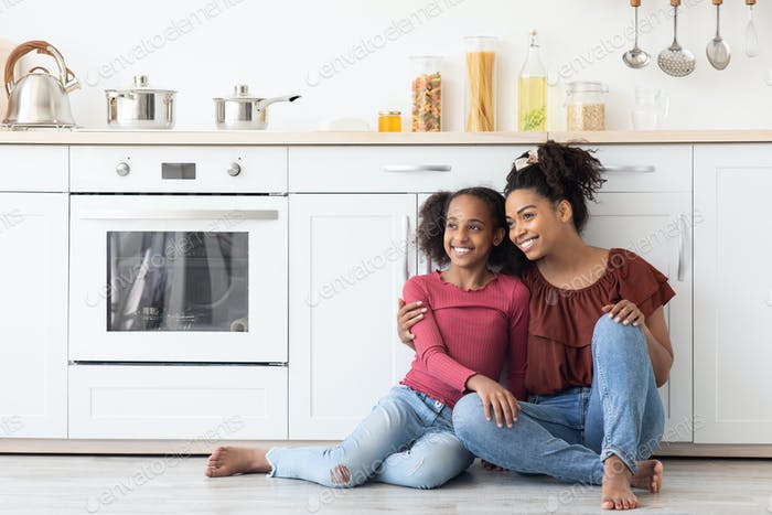 Happy black girl teenager and woman looking at copy space