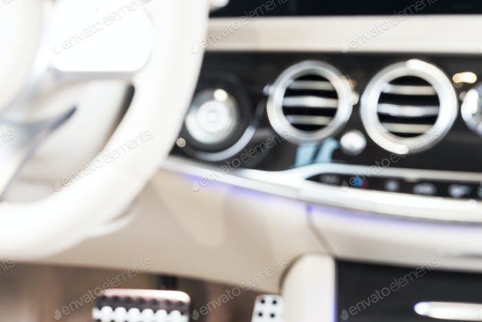 Blurred image of modern car interior