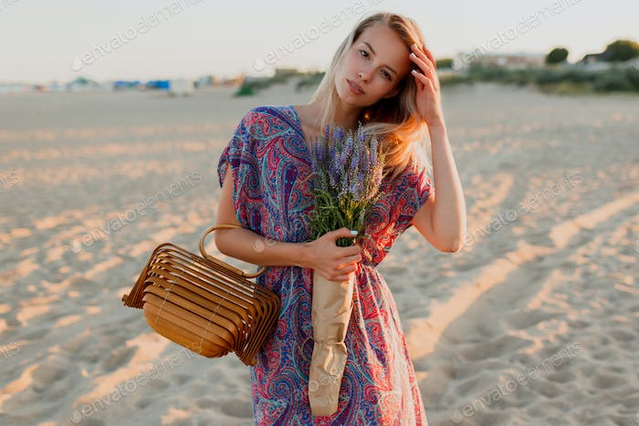 Pretty blonde woman with bouquet of lavender.