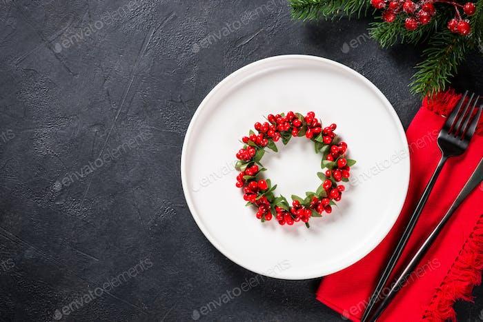 Christmas table setting on black top view