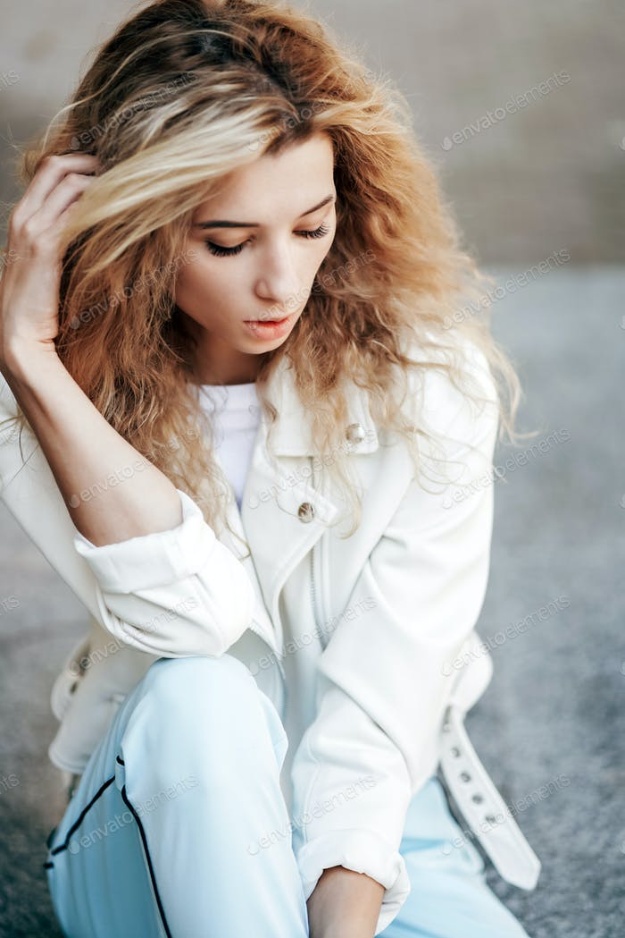 beautiful young girl posing at the camera