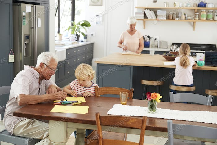 Grandparents and grandkids in family kitchen, elevated view