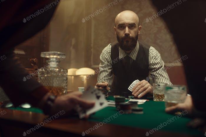 The poker players in casino, blackjack