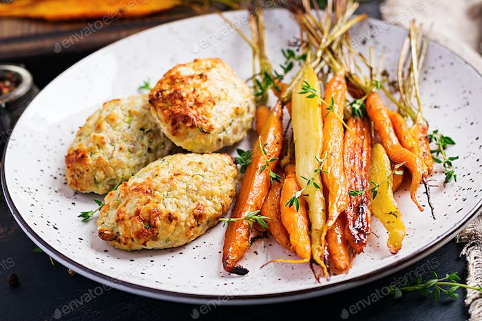 Baked organic carrots with thyme and cutlet/meatball chicken meat and zucchini. Diet food.