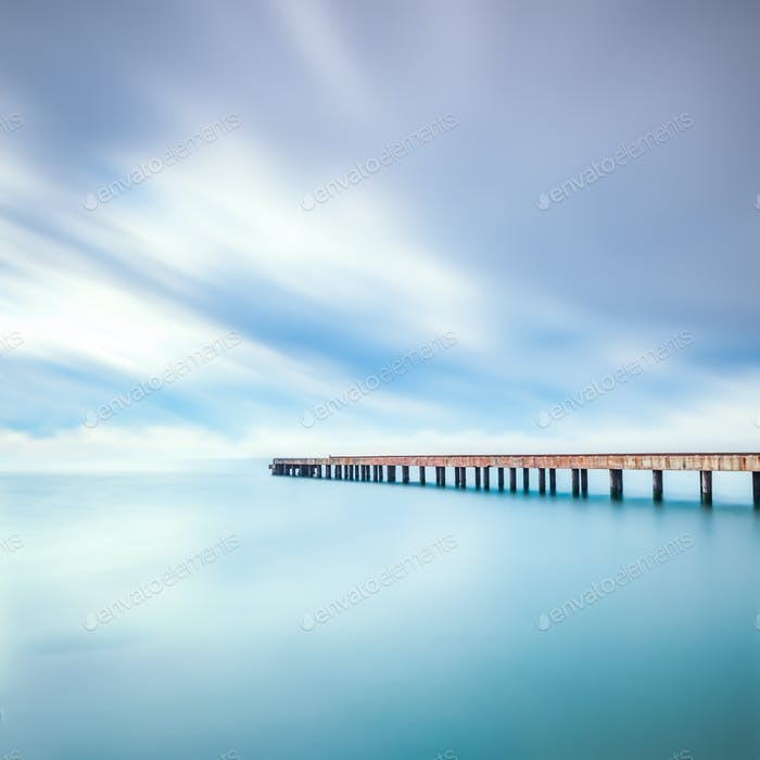 Concrete pier or jetty on a sea. Marina di Carrara, Tuscany, Ita