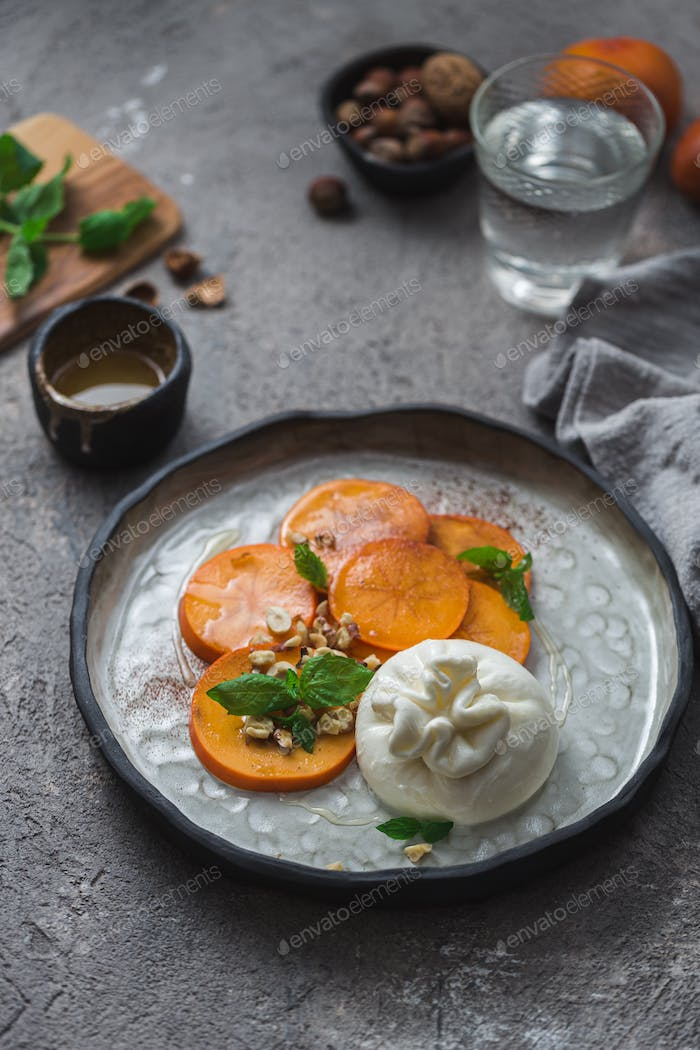 Persimmon and buratta cheese with nuts and honey