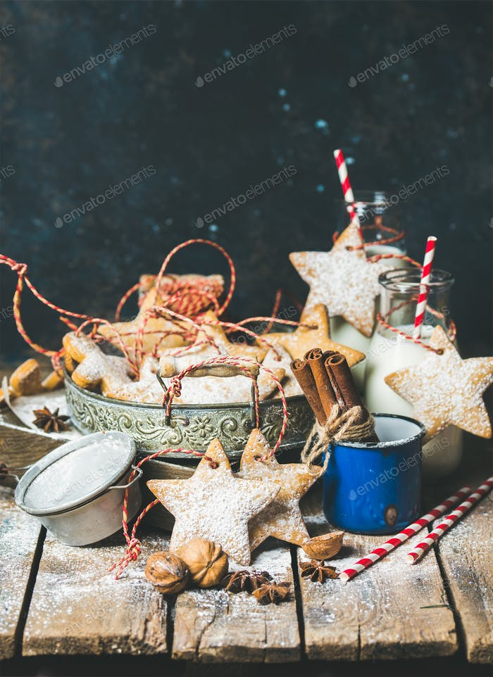 Christmas cookies, decoration rope, nuts, spices, milk, sugar powder