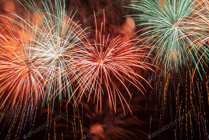 Colorful red fireworks in the night sky