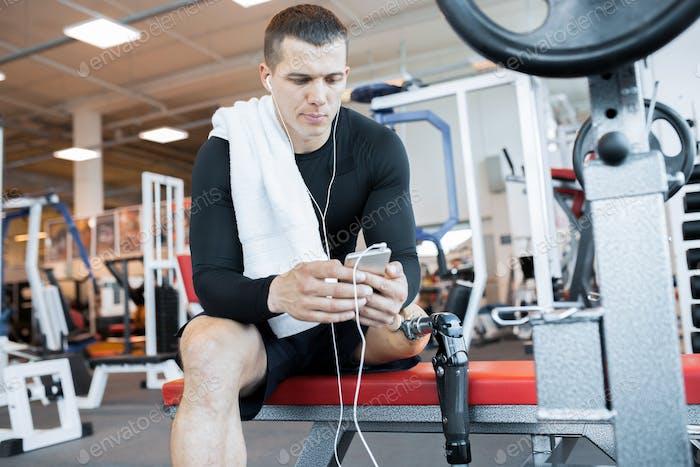 Adaptive Athlete Taking Break in Gym