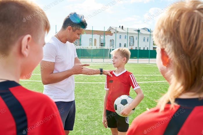 Coach Motivating Young Players