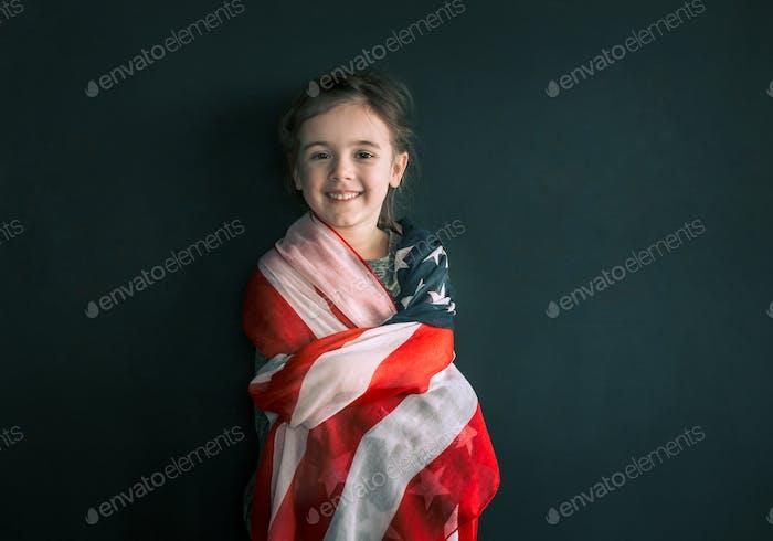 Niña con la bandera americana