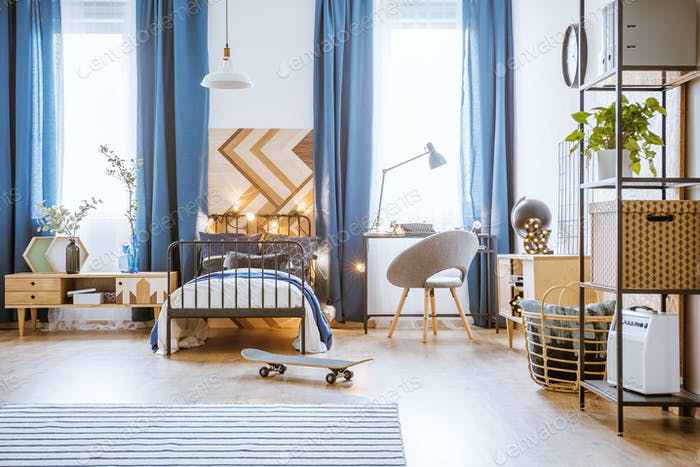 Skateboard in blue bedroom interior