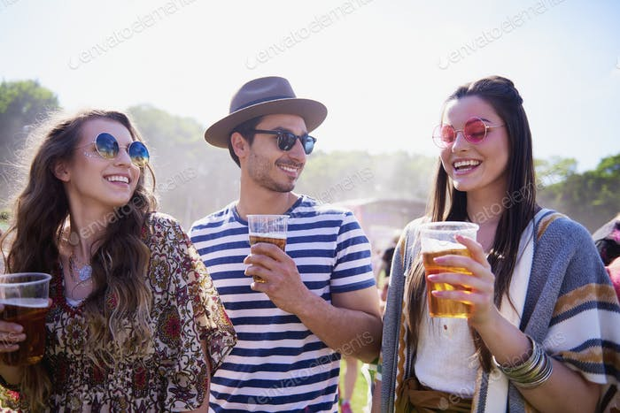 Three the best friends drinking beer outdoors