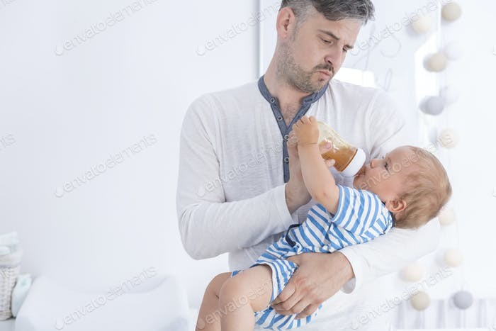 Father feeding his baby