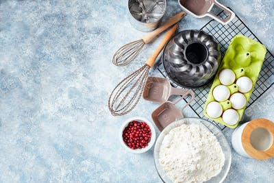 Baking ingredients and utensils, flour, eggs, baking dish.