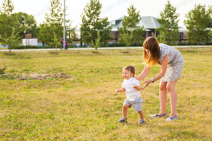 Mother and Son Having Fun in summer nature