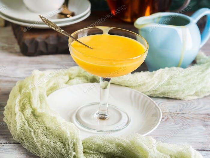 Lemon curd served in stemmed glass
