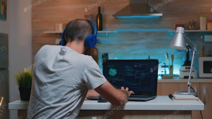 Man hacker coding html and programming on screen laptop