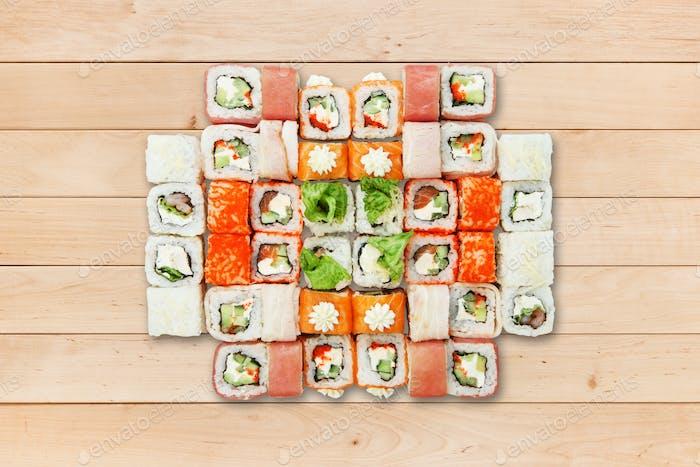 Set of sushi california rolls at wood.