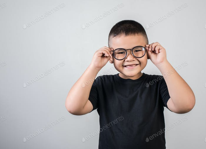 Funny boy genius wearing glasses in studio shot