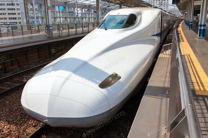 White Shinkansen Bullet Train waiting at a platform of Tokyo Station, Japan.