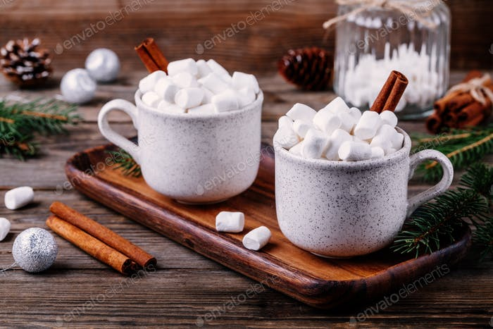 Christmas drink. Hot chocolate with marshmallows and cinnamon on dark wooden background.