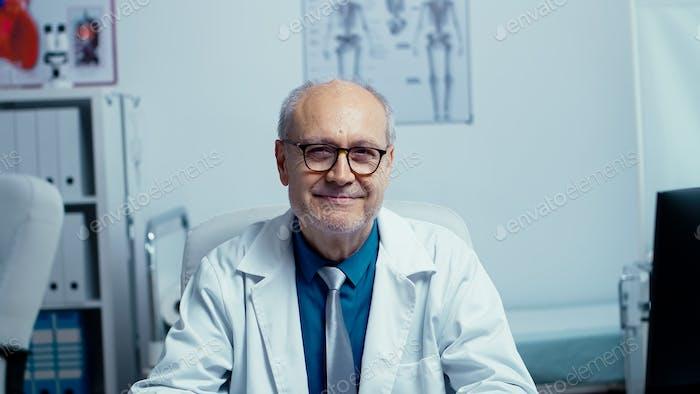 Authentic portrait of elderly experienced doctor