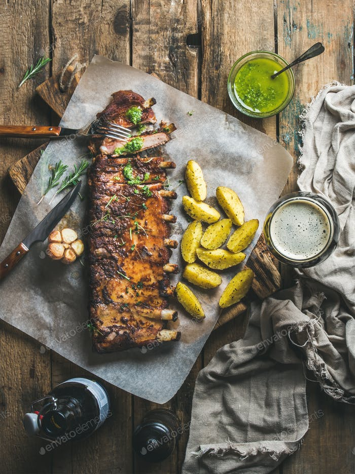 Roasted pork ribs with spices, fried potato and dark beer