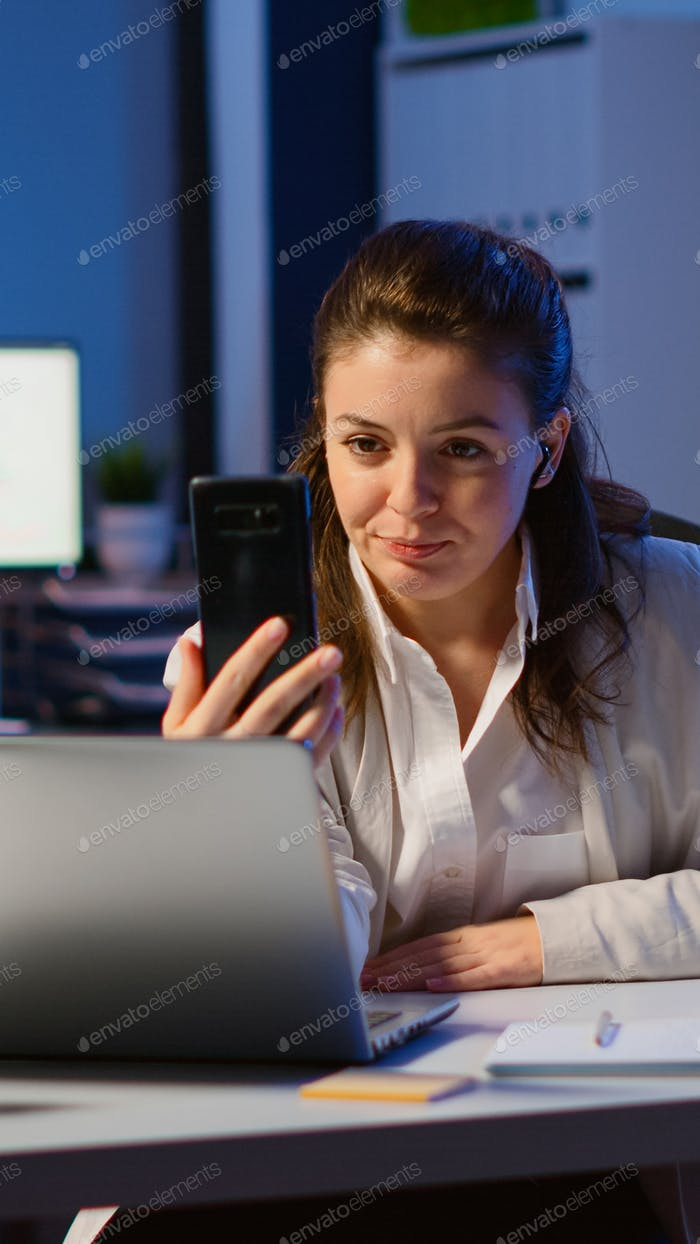Business woman discussing during video conference with partners using smartphone