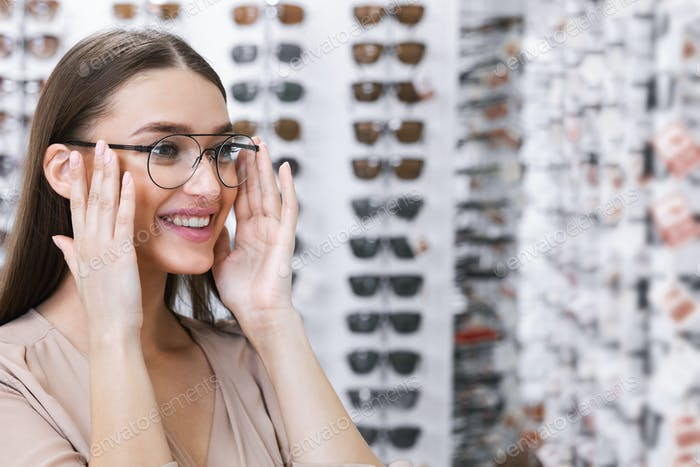 Portrait of young lady wearing spectacles in store