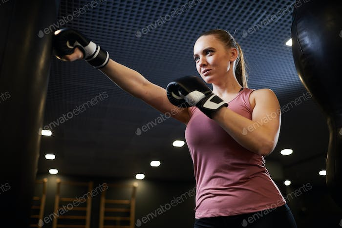 Focused Young Woman Boxing