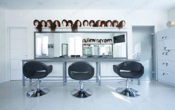 Interior in beauty salon. Chairs for clients and mirror
