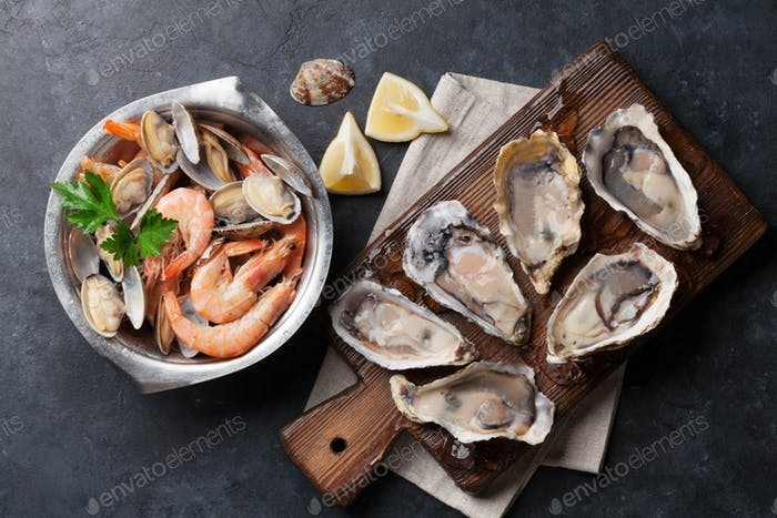 Fresh seafood. Scallops, oysters and shrimps