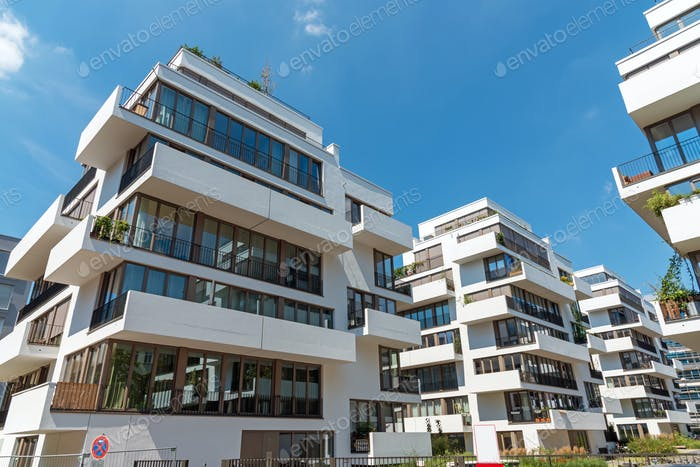 Modern white townhouses on a sunny day