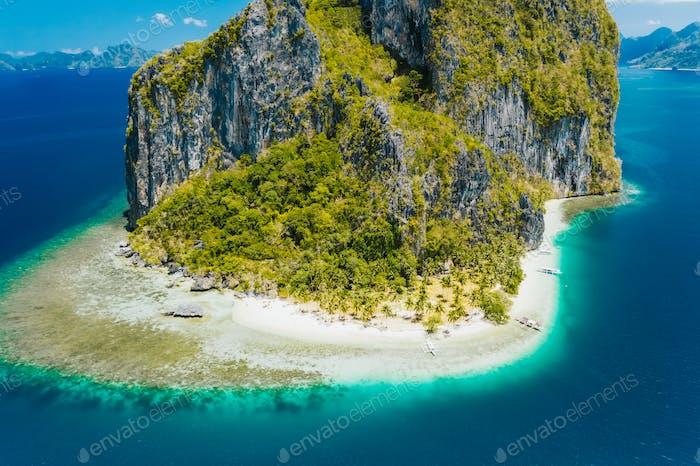 El Nido, Palawan, Philippines. Aerial drone view of impressive Pinagbuyutan Island. Amazing white