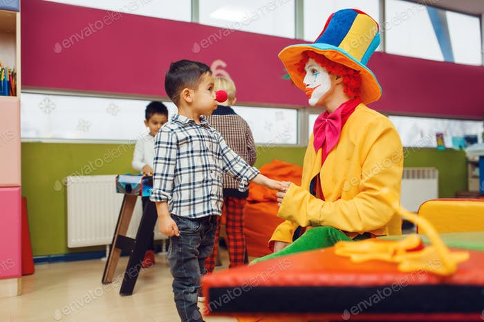 Funny clown and little boy with red nose