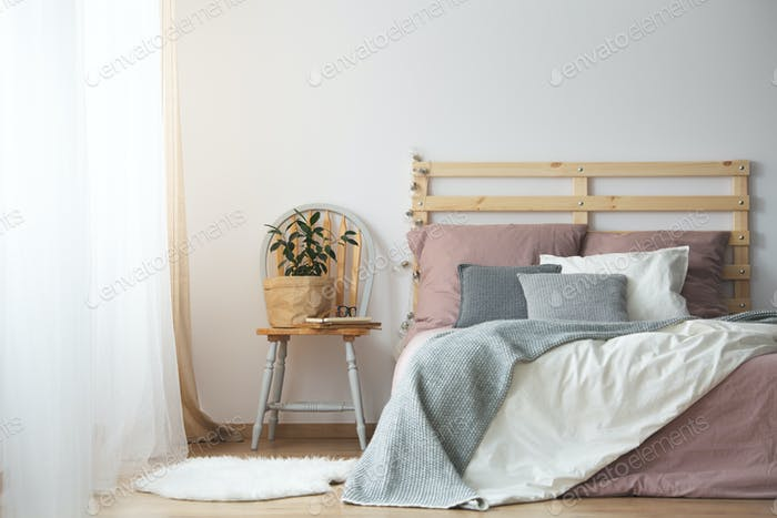 Wooden bed in bedroom