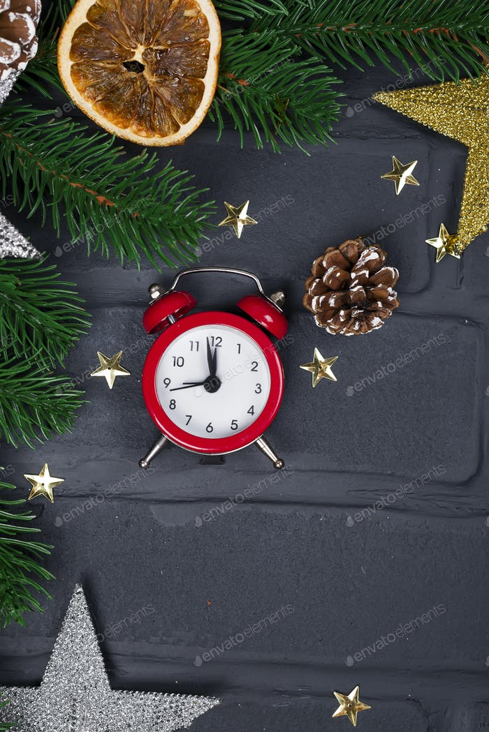 Christmas fir tree with decoration and red clock