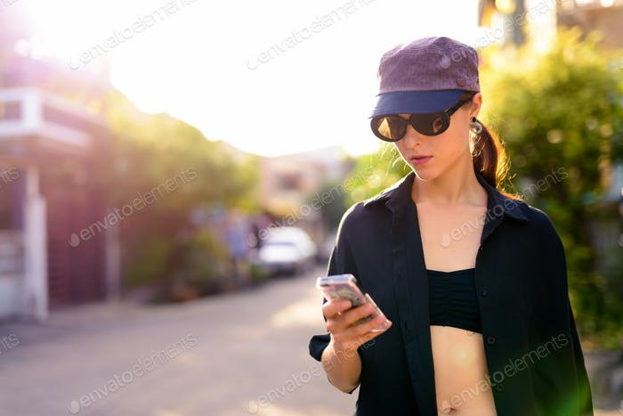 Portrait of young beautiful woman in the city streets outdoors