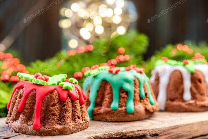 Christmas Pudding Cake in Festive Decoration on Christmas Table