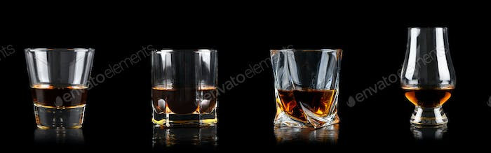 Set of four glass of whiskey on black background