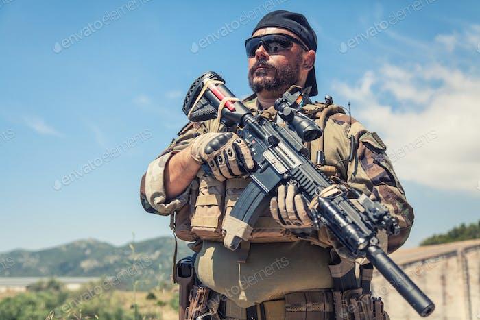 Private military company mercenary with gun