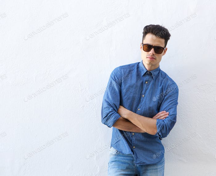 confident young man posing with sunglasses
