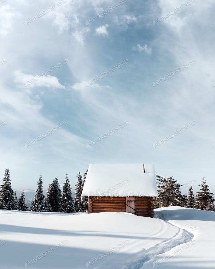 Fantastic landscape with snowy house