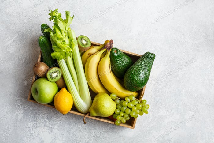 Box with fruits and green vegetables