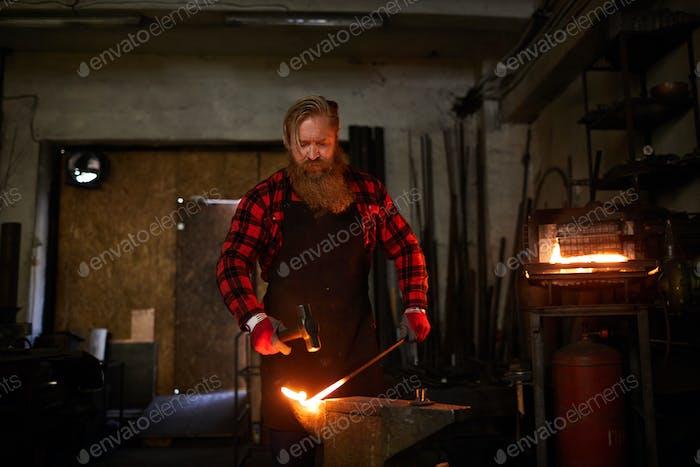Blacksmith in workshop