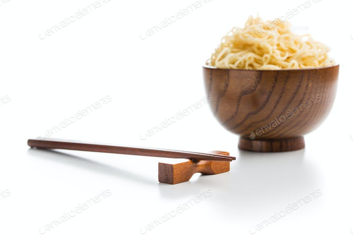 Wooden chopsticks and instant noodles.