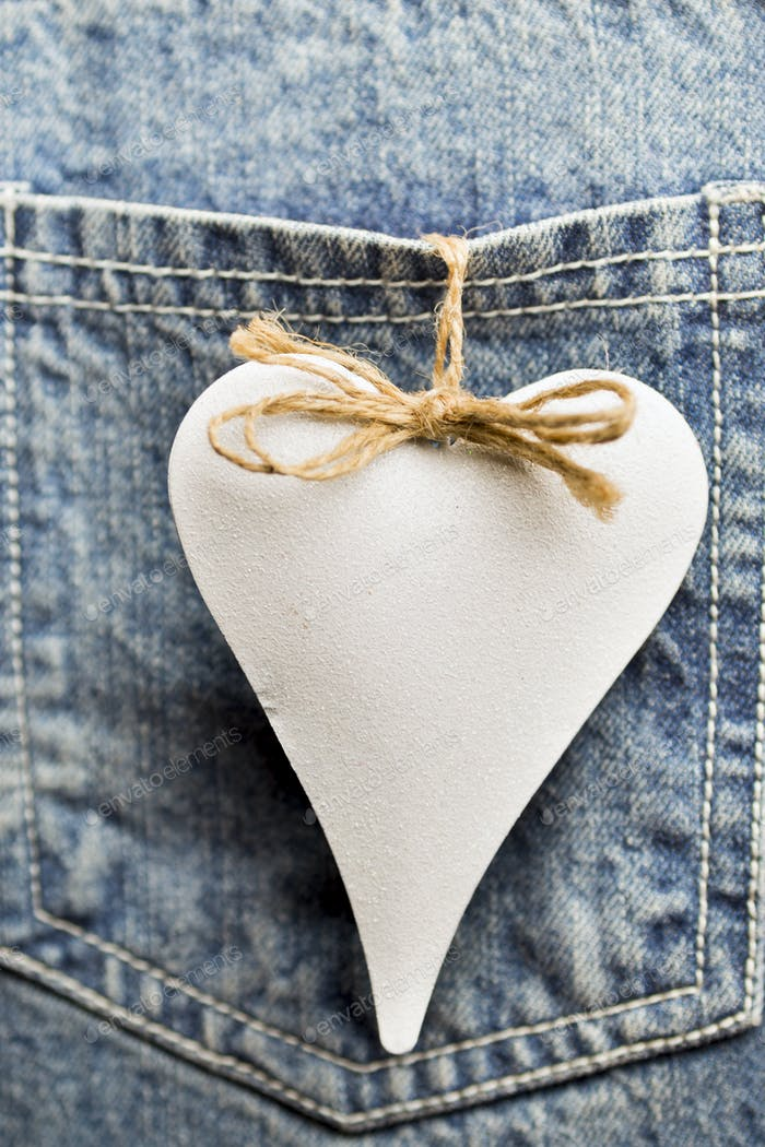 Blue jeans texture pocket and red heart.