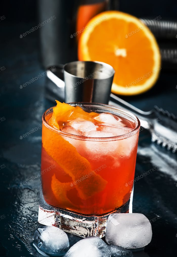 Garibaldi alcoholic cocktail with red bitter, orange juice, zest and ice