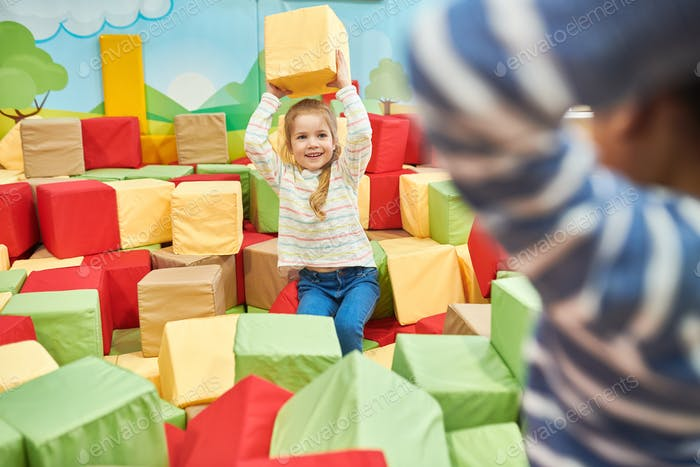 Two Kids Playing in Foam Pit